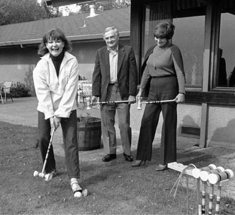 Sinsheimers and unidentified woman playing croquet at University House, 1982